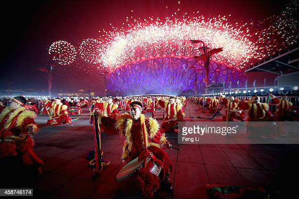Chinese dancers perform in front of the National Stadium known as 'Bird's Nest' during the fireworks show of the Welcome Banquet for 2014 APEC...