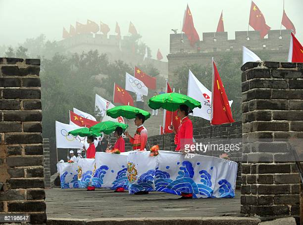 Chinese dancers performs during the Olympic Torch relay along a section of the Great Wall in Badaling outside Beijing on August 07 2008 a day before...