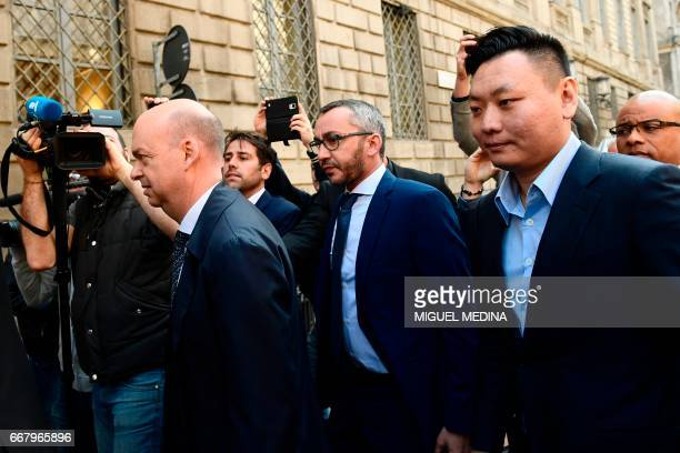 Chinese David Han Li and Italian Marco Fassone representatives of Chinese consortium SinoEurope Sports arrive to finalize the deal with Fininvest the...