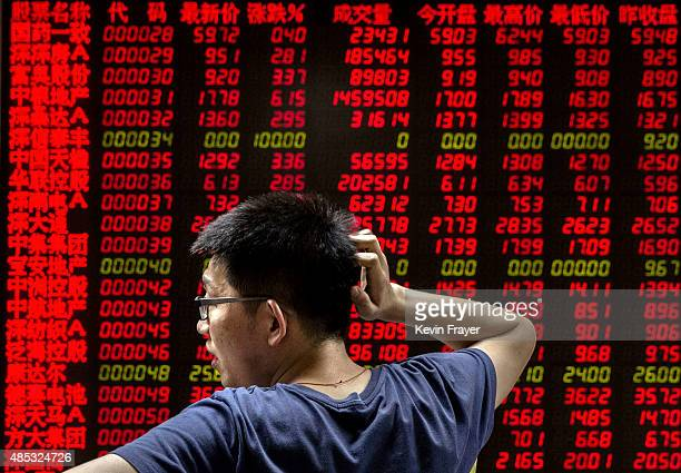 Chinese day trader reacts as he watches a stock ticker at a local brokerage house on August 27 2015 in Beijing China A dramatic selloff in Chinese...