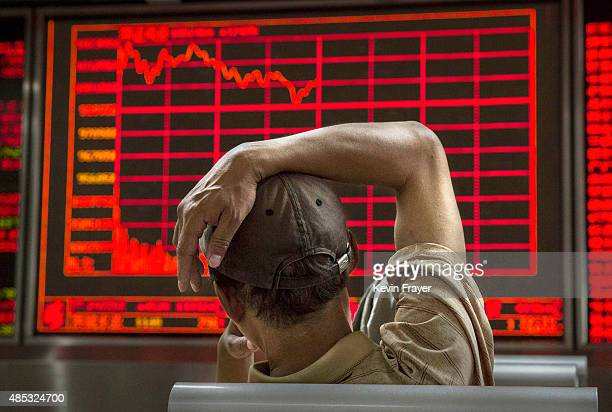 Chinese day trader watches a stock ticker at a local brokerage house on August 27 2015 in Beijing China A dramatic selloff in Chinese stocks caused...