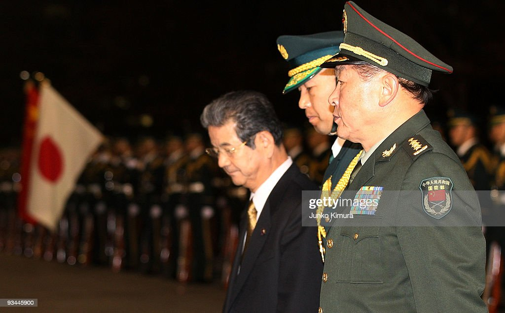 Chinese Defence Minister Liang Guanglie (R) reviews a guard of honor with Japanese Defense Minister Toshimi Kitazawa (L) at Defense Ministry on November 27, 2009 in Tokyo, Japan. Liang is in Japan until December 1 to discuess issues on North East Asia.