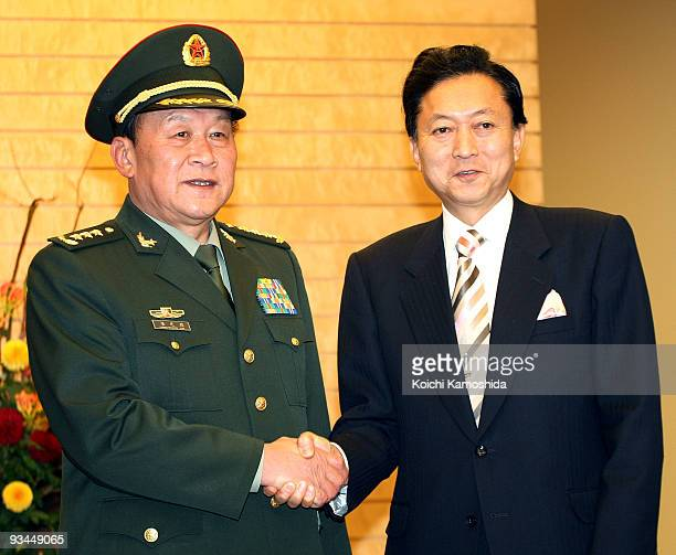 Chinese Defence Minister Liang Guanglie shakes hands with Japanese Prime Minister Yukio Hatoyama prior to their meeting at Hatoyama's official...