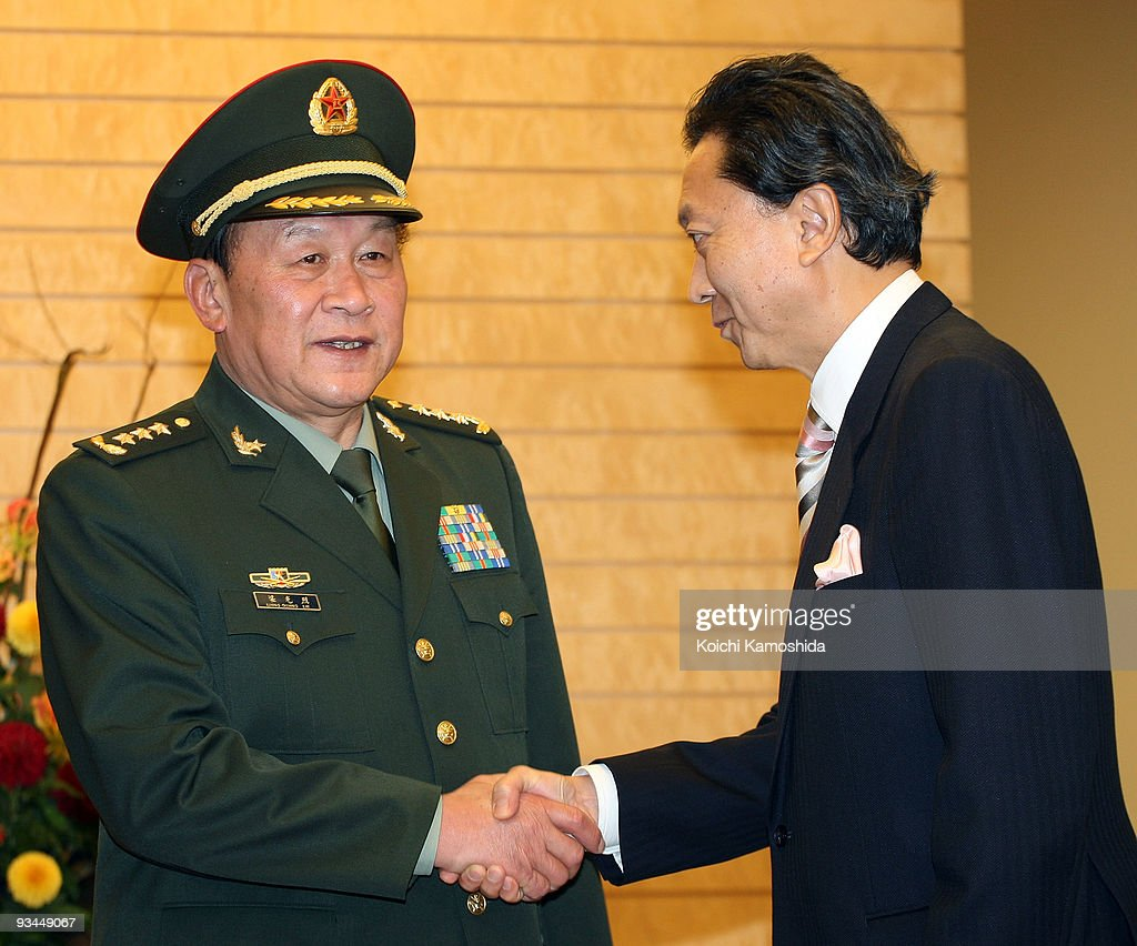 Chinese Defence Minister Liang Guanglie (L) shakes hands with Japanese Prime Minister Yukio Hatoyama (R) prior to their meeting at Hatoyama's official residence on November 27, 2009 in Tokyo, Japan. Liang is in Japan until December 1 to discuess issues on North East Asia.