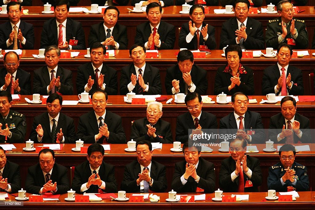 Chinese delegates applaud the result of a vote during the Chinese Communist Party Congress at the Great Hall of the People on October 21 2007 in...