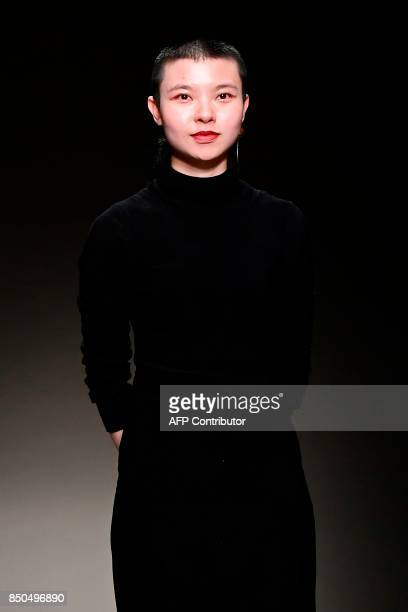 Chinese designer Angel Chen greets the audience at the end of the show during the Women's Spring/Summer 2018 fashion shows in Milan on September 20...