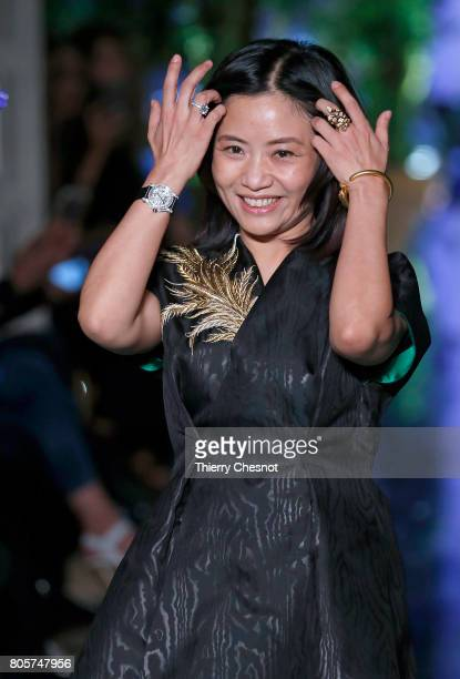 Chinese designer Guo Pei acknowledges the audience at the end of the Guo Pei Haute Couture Fall/Winter 20172018 show as part of Haute Couture Paris...