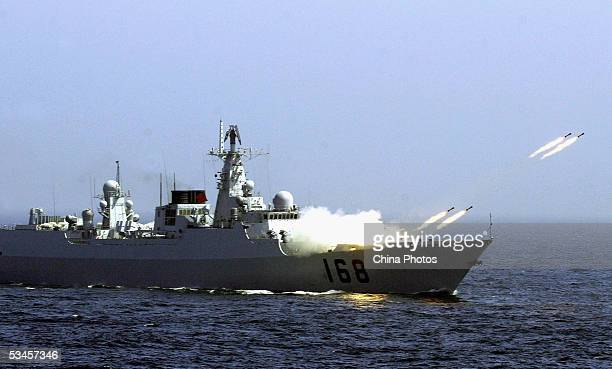 A Chinese destroyer launches missiles in an offshore blockade exercise during the third phase of the SinoRussian 'Peace Mission 2005' joint military...