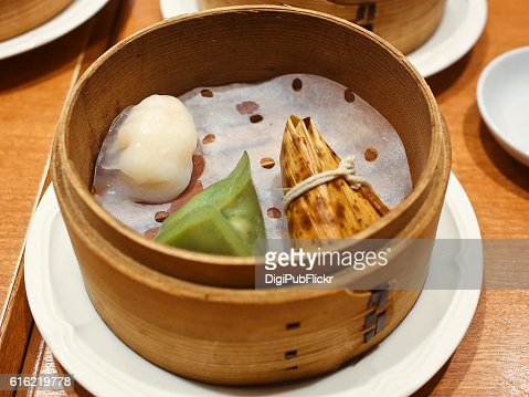 Chinese Dim Sum Served in Wood Steamer on Table : Stock Photo