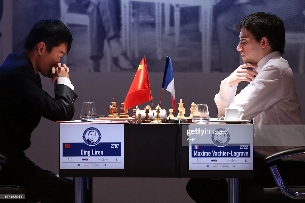 Chinese Ding Liren (L) and French Maxime Vachier-Lagrave play during a round 2 game of the Alekhine Memorial chess tournament on April 22, 2013 in Paris. The tournament is a 10-player single round competition, with the first half held in Paris from April 20 to 25, and the second half in the Russian State Museum in St. Petersburg from APril 26 to May 1st.