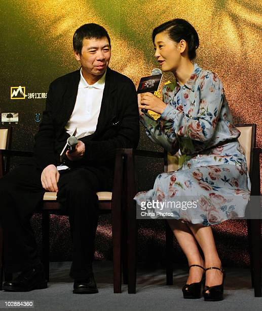 Chinese director Feng Xiaogang and actress Xu Fan attend the premiere of IMAX film 'Aftershock' featuring the 1976 Tangshan earthquake that killed...