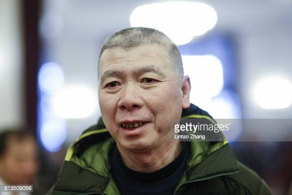 Chinese director Feng Xiaogang attends opening session of the Chinese People's Political Consultative Conference on March 3 2016 in Beijing China...