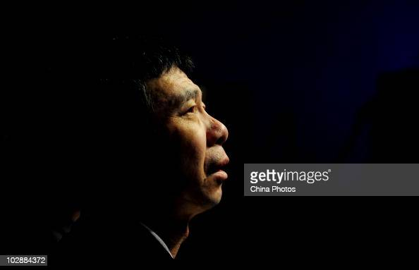 Chinese director Feng Xiaogang attends the premiere of IMAX film 'Aftershock' featuring the 1976 Tangshan earthquake that killed 300000 people on...