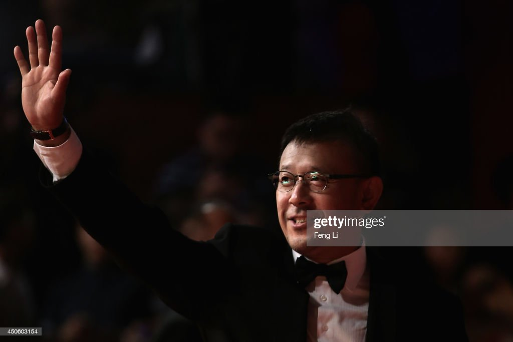 Chinese director <a gi-track='captionPersonalityLinkClicked' href=/galleries/search?phrase=Jiang+Wen&family=editorial&specificpeople=774654 ng-click='$event.stopPropagation()'>Jiang Wen</a> arrives for the red carpet of the 17th Shanghai International Film Festival at Shanghai Grand Theatre on June 14, 2014 in Shanghai, China.