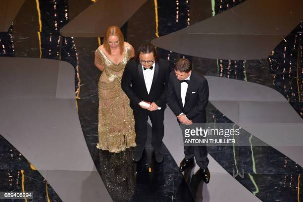 Chinese director Qiu Yang stands on stage with US actress and President of the Un Certain Regard jury Uma Thurman and Romanian director and President...