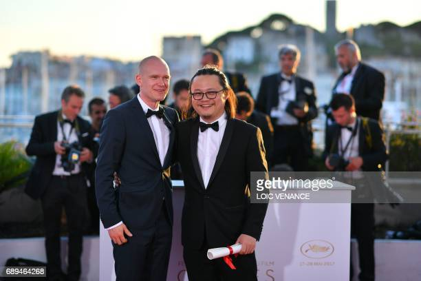Chinese director Qiu Yang winner of the Palme d'Or Short Film for 'Xiao Cheng Er Yue' and Finnish director Teppo Airaksinen winner of the jury's...