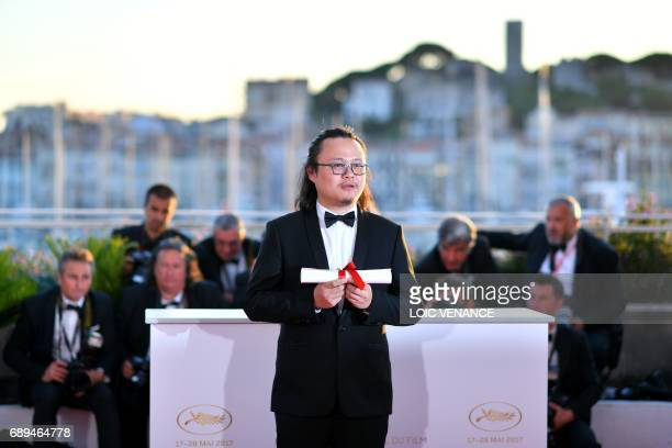 Chinese director Qiu Yang winner of the Palme d'Or Short Film for 'Xiao Cheng Er Yue' poses during a photocall on May 28 2017 at the 70th edition of...