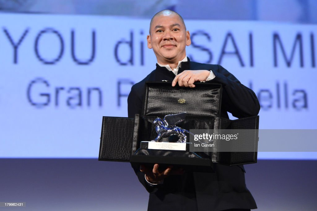 Chinese director Tsai Ming-Liang poses with the Grand Jury Price on stage during the Closing Ceremony at the 70th Venice International Film Festival at the Palazzo del Casino on September 7, 2013 in Venice, Italy.