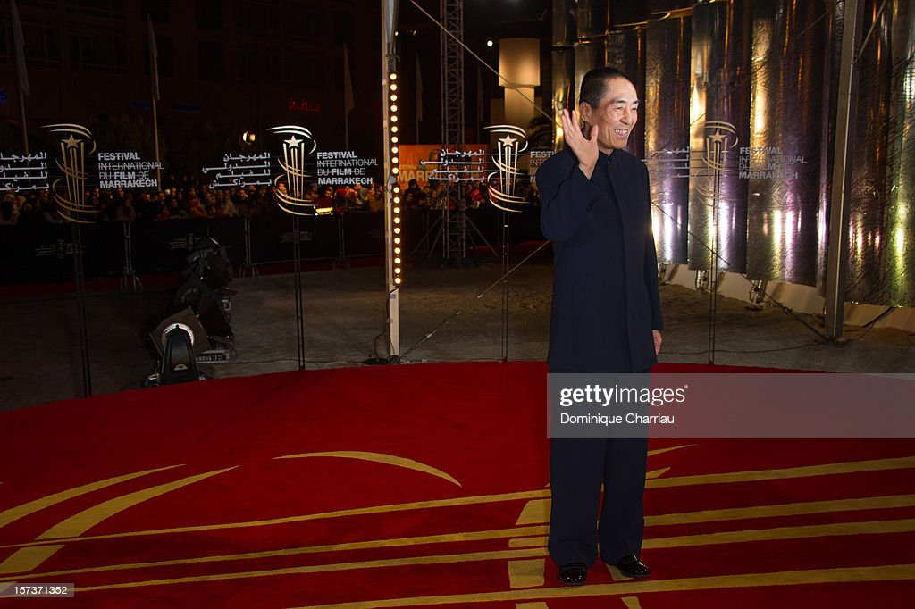 Chinese Director <a gi-track='captionPersonalityLinkClicked' href=/galleries/search?phrase=Zhang+Yimou&family=editorial&specificpeople=211304 ng-click='$event.stopPropagation()'>Zhang Yimou</a> arrives to his Tribute during the 12th International Marrakech Film Festival on December 2, 2012 in Marrakech, Morocco.