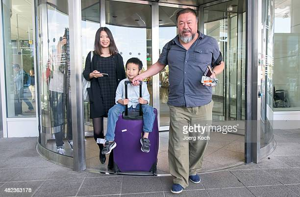 Chinese dissident artist Ai Weiwei leaves Munich Airport with is his wife Lu Qing and his son Ai Lao aged 6 on July 30 2015 in Munich Germany This is...