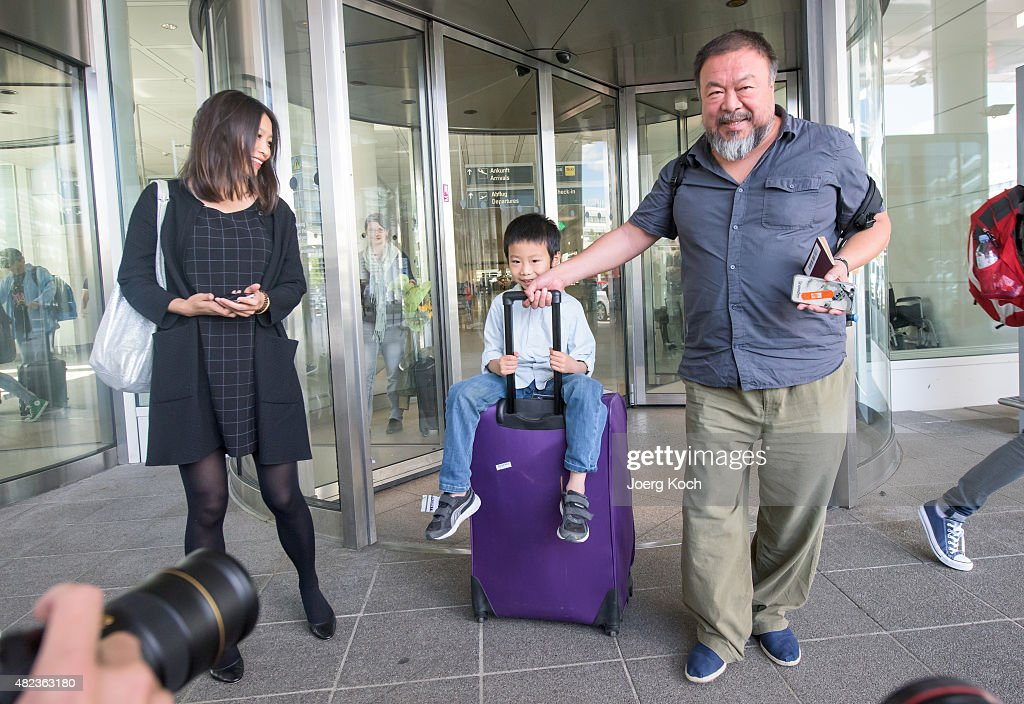 Chinese dissident artist Ai Weiwei leaves Munich Airport with is his wife Lu Qing and his son Ai Lao, aged 6, on July 30, 2015 in Munich, Germany. This is his first trip abroad since Chinese authorities put him under house arrest in 2011 and confiscated his passport without charging him with any crime. They recently returned his passport, enabling Ai Weiwei to travel to see his son, who lives in Berlin. His 6-month UK visa application, however, has been rejected because the artist failed to mention any convictions, although he has been granted a 20-day visa to attend the opening of his show in London in September.