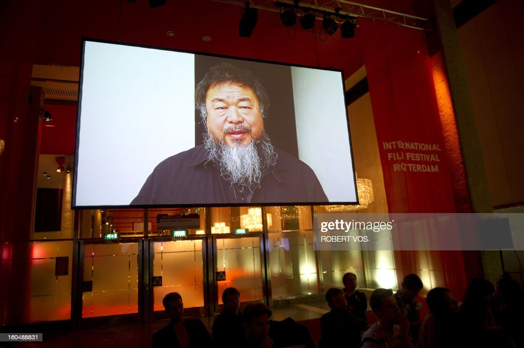 Chinese dissident artist Ai Weiwei, member of the jury, announces on a screen the winners of the 18th edition of the Hivos Tiger Awards in Rotterdam, in the Netherlands, on February 1, 2013. The yearly awards took place at the International Film Festival Rotterdam. Because he is not permitted to leave Beijing, Ai Wei Wei performed his jury duties from a distance and communicated with the other jury members using Skype. AFP PHOTO / ANP / ROBERT VOS netherlands out