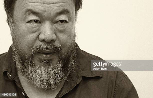 Chinese dissident artist Ai Weiwei pauses as he signs books for fans after a panel discussion at the Berlin International Literature Festival on...