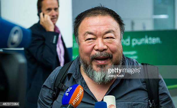 Chinese dissident artist Ai Weiwei speaks to the media upon his arrival at Munich Airport on July 30 2015 in Munich Germany This is his first trip...