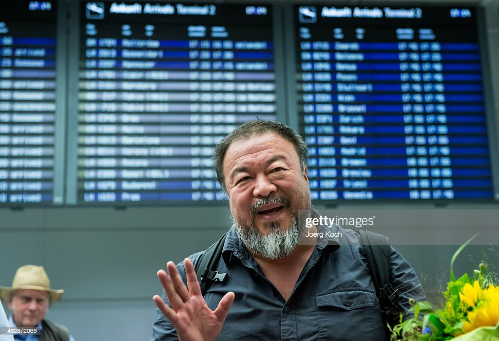 Chinese dissident artist <a gi-track='captionPersonalityLinkClicked' href=/galleries/search?phrase=Ai+Weiwei&family=editorial&specificpeople=4331218 ng-click='$event.stopPropagation()'>Ai Weiwei</a> upon his arrival at Munich Airport on July 30, 2015 in Munich, Germany. This is his first trip abroad since Chinese authorities put him under house arrest in 2011 and confiscated his passport without charging him with any crime. They recently returned his passport, enabling <a gi-track='captionPersonalityLinkClicked' href=/galleries/search?phrase=Ai+Weiwei&family=editorial&specificpeople=4331218 ng-click='$event.stopPropagation()'>Ai Weiwei</a> to travel to see his son, who lives in Berlin. His 6-month UK visa application, however, has been rejected because the artist failed to mention any convictions, although he has been granted a 20-day visa to attend the opening of his show in London in September.