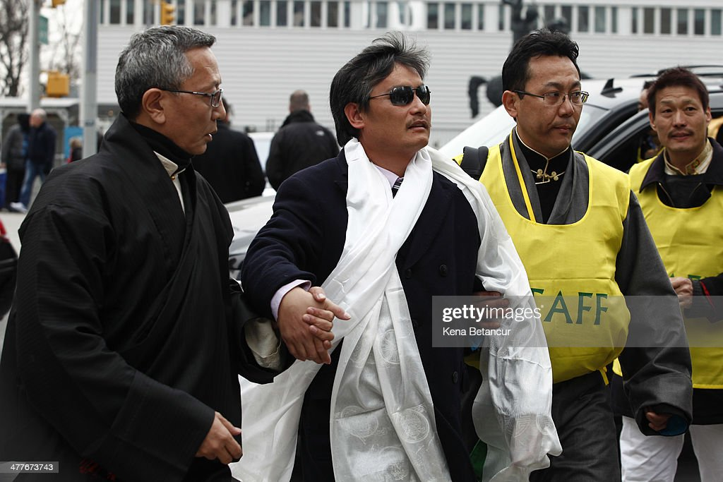 Chinese dissident <a gi-track='captionPersonalityLinkClicked' href=/galleries/search?phrase=Chen+Guangcheng&family=editorial&specificpeople=4103134 ng-click='$event.stopPropagation()'>Chen Guangcheng</a> (C) attends the 55th anniversary of the Tibetan national uprising day rally outside the United Nations building on March 10, 2014, in New York City. On this day in 1959, an uprising against China's occupation of the autonomous region of Tibet took place, forcing spiritual leader the Dalai Lama to flee into exile.