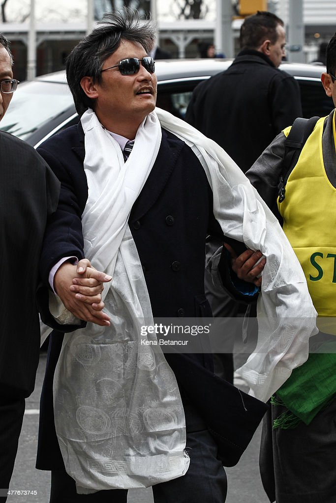 Chinese dissident Chen Guangcheng (C) attends the 55th anniversary of the Tibetan national uprising day rally outside the United Nations building on March 10, 2014, in New York City. On this day in 1959, an uprising against China's occupation of the autonomous region of Tibet took place, forcing spiritual leader the Dalai Lama to flee into exile.