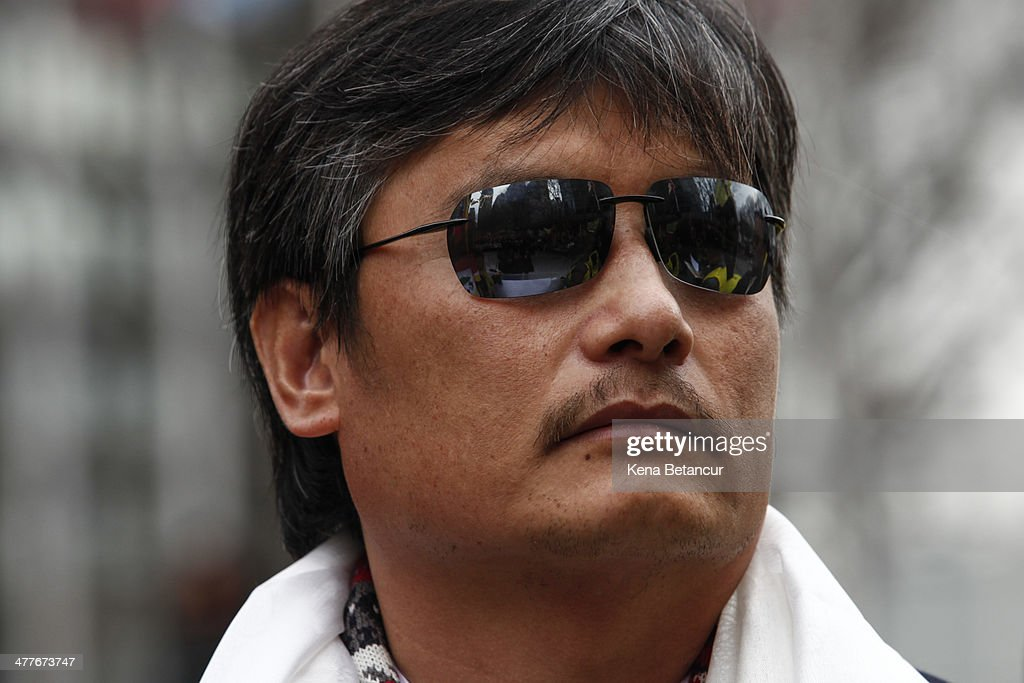 Chinese dissident <a gi-track='captionPersonalityLinkClicked' href=/galleries/search?phrase=Chen+Guangcheng&family=editorial&specificpeople=4103134 ng-click='$event.stopPropagation()'>Chen Guangcheng</a> attends the 55th anniversary of the Tibetan national uprising day rally outside the United Nations building on March 10, 2014, in New York City. On this day in 1959, an uprising against China's occupation of the autonomous region of Tibet took place, forcing spiritual leader the Dalai Lama to flee into exile.