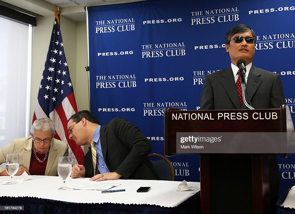 Chinese dissident Chen Guangcheng speaks while Jared Genser of Freedom Now and Sophie Richardson China director of Human Rights Watch sit nearby at...