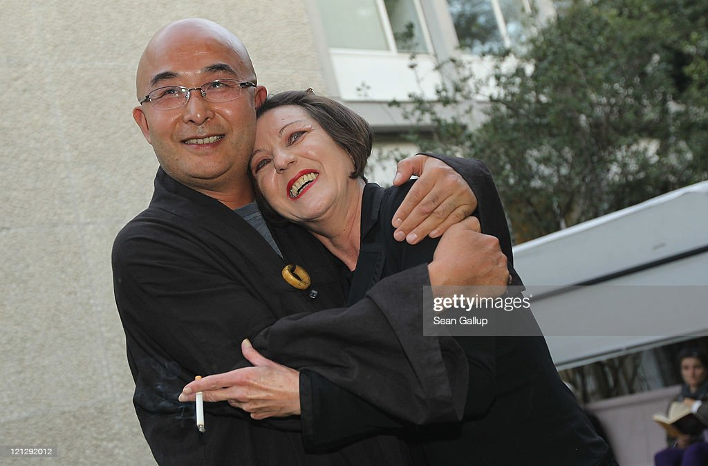 "Chinese dissident writer Liao Yiwu is greeted by German writer <a gi-track='captionPersonalityLinkClicked' href=/galleries/search?phrase=Herta+Mueller&family=editorial&specificpeople=6356303 ng-click='$event.stopPropagation()'>Herta Mueller</a> at the Haus der Berliner Festspiele during the Berlin International Literature Festival on August 17, 2011 in Berlin, Germany. Liao, who fled China after spending years in prison, read from his new book ""A Song and A Hundred Songs,"" in which he recounts his prison experiences, including being tortured by Chinese prison authorities."
