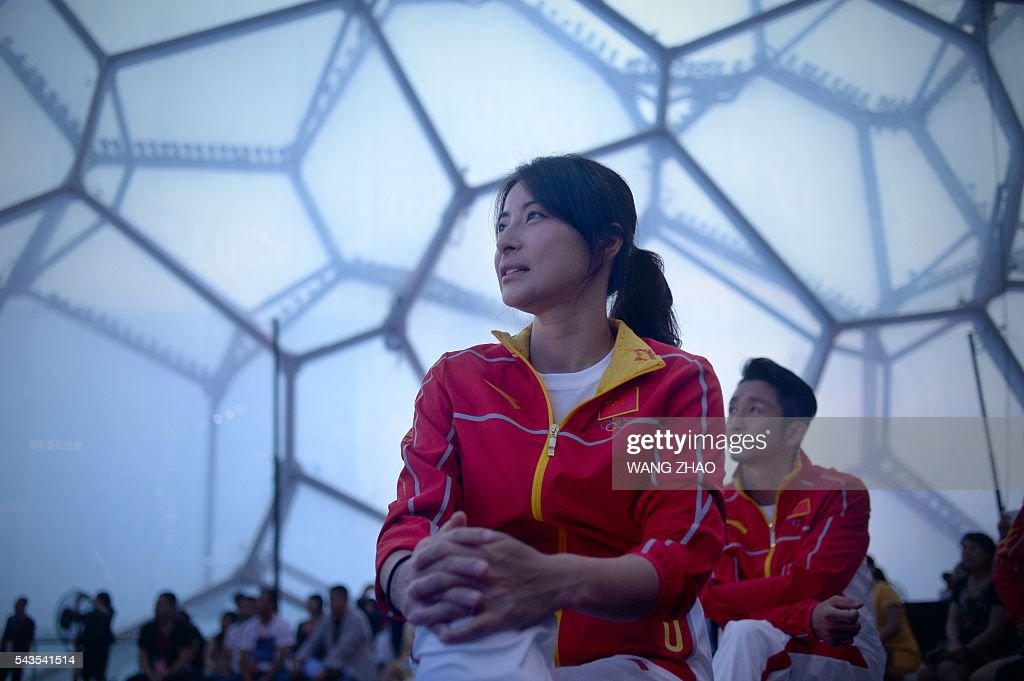 Chinese diver Guo Jingjing looks on during a ceremony to unveil the Chinese Olympic team's uniforms for the Rio 2016 Olympic Games, in Beijing on June 29, 2016. The uniforms were unveiled at a ceremony in the Water Cube, the venue for the swimming competition at the 2008 Beijing Olympic Games. / AFP / WANG