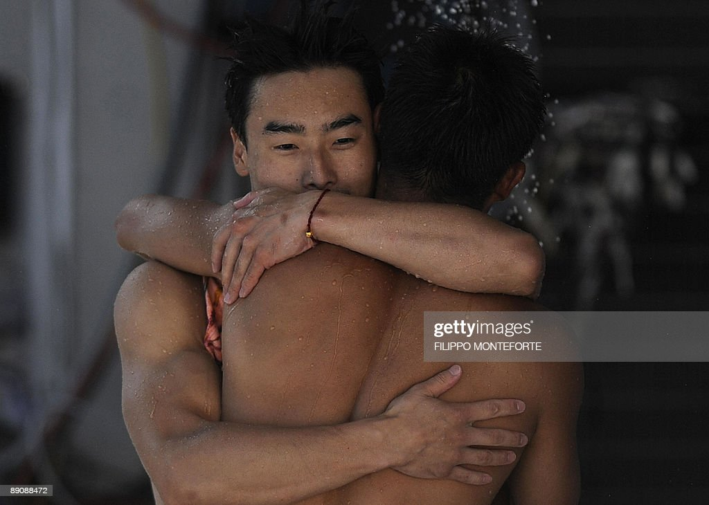 Chinese divers Qin Kai and Wang Feng celebrate during the diving Men's 3m springboard synchronised final on July 18 2009 at the FINA World...