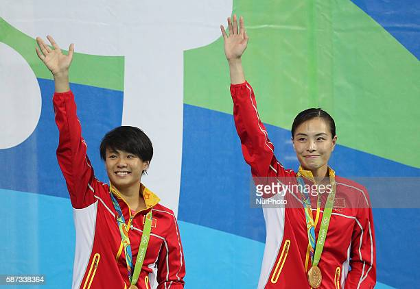 Chinese diving athletes Wu Minxia and Shi Tingmao wave to spectators at the awarding ceremony of women's SYNC3M Springboard in Rio de Janeiro Brazil...