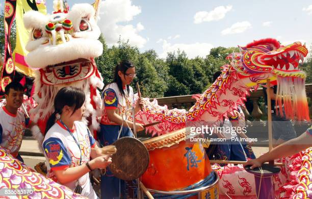 A Chinese dragon float as The West End Festival gets under way with 'Scotland's Mardi Gras' where over one thousand costumed performers and bands...