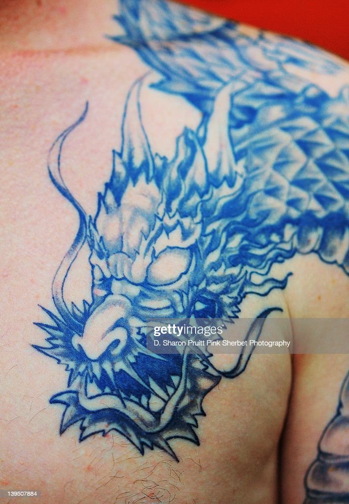 Chinese dragon head tattoo on mans chest : Stock Photo