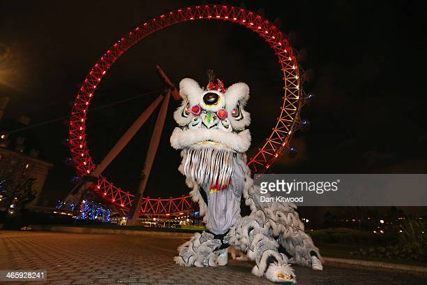 Chinese Dragon poses in front of the London Eye during a photocall ahead of Chinese New Year on January 30 2014 in London England The Chinese Lunar...
