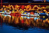 Chinese dragon sculptures lit up at night, Nanjing, Jiangsu Province, China