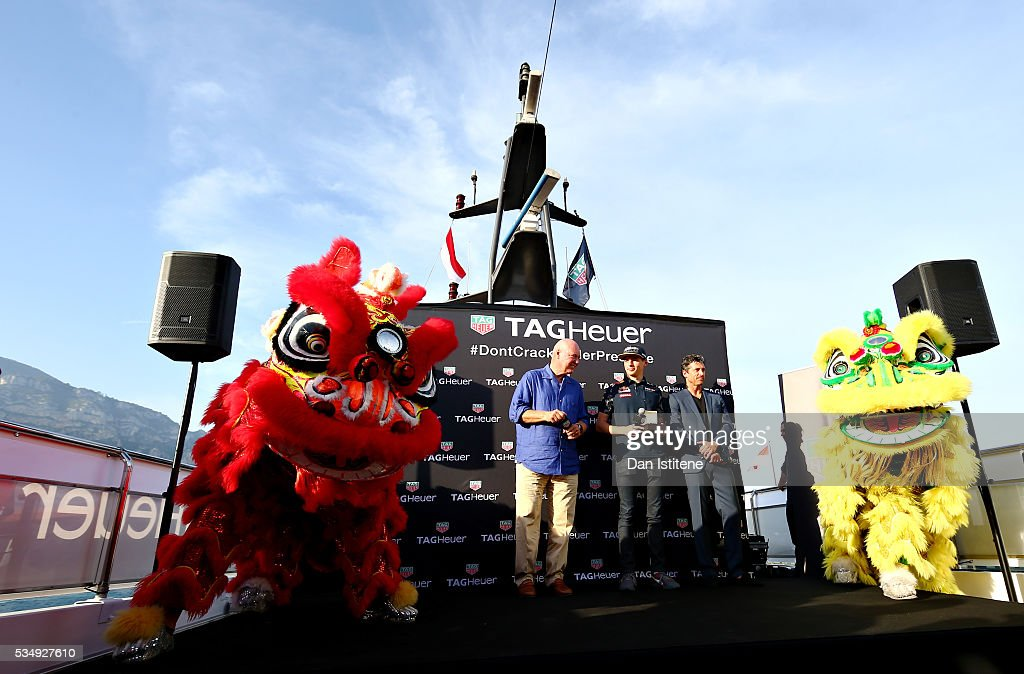 Chinese dragons dance around on stage next to Jean-Claude Biver, CEO of TAG Heuer, <a gi-track='captionPersonalityLinkClicked' href=/galleries/search?phrase=Max+Verstappen&family=editorial&specificpeople=12813205 ng-click='$event.stopPropagation()'>Max Verstappen</a> of Netherlands and Red Bull Racing, and <a gi-track='captionPersonalityLinkClicked' href=/galleries/search?phrase=Patrick+Dempsey&family=editorial&specificpeople=241264 ng-click='$event.stopPropagation()'>Patrick Dempsey</a>, actor on stage at a TAG-Heuer event in Port Hercule de Monaco on May 28, 2016 in Monaco, Monaco.