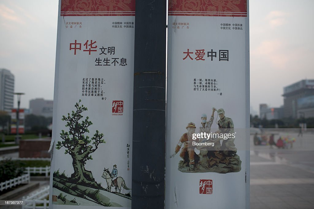 'Chinese Dream' posters hang at Spring City Square in Jinan, China, on Wednesday, Nov. 6, 2013. The third plenary session of the 18th Communist Party of China Central Committee will be held from Nov. 9 to Nov. 12 in Beijing. Photographer: Brent Lewin/Bloomberg via Getty Images