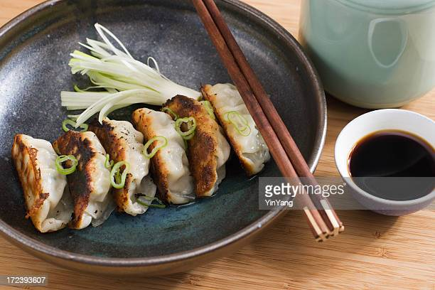 Chinese Dumplings, Asian Fried Potsticker Appetizers Served with Soy Sauce