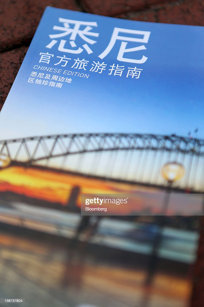 A Chinese edition Sydney tourist information booklet is arranged for a photograph in Sydney, Australia, on Monday, Dec. 24, 2012. At least 150,000 people from mainland China and across Asia are projected to descend on Sydney, Australia's most populous city, during the New Year's Eve and Chinese New Year period. Photographer: Brendon Thorne/Bloomberg via Getty Images