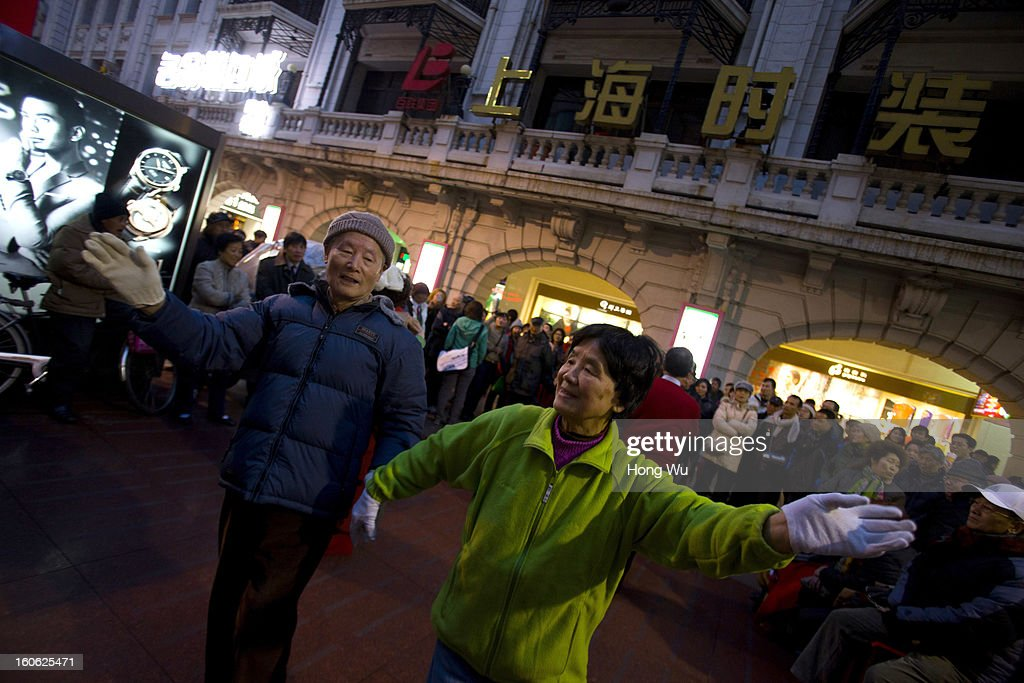 Chinese elder people dance in Nanjing Road Walking Street on February 3, 2013 in Shanghai, China.