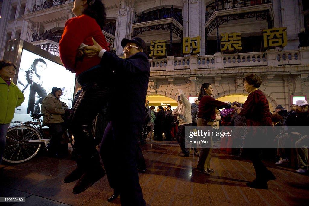 Chinese elder people dance in Nanjing Road Walking Street on February 3, 2013 in Shanghai, China.