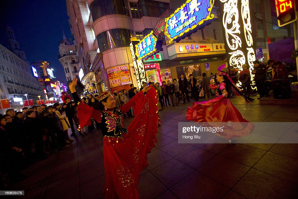 Chinese elder people perform Xinjiang dance in Nanjing Road Walking Street on February 3, 2013 in Shanghai, China.