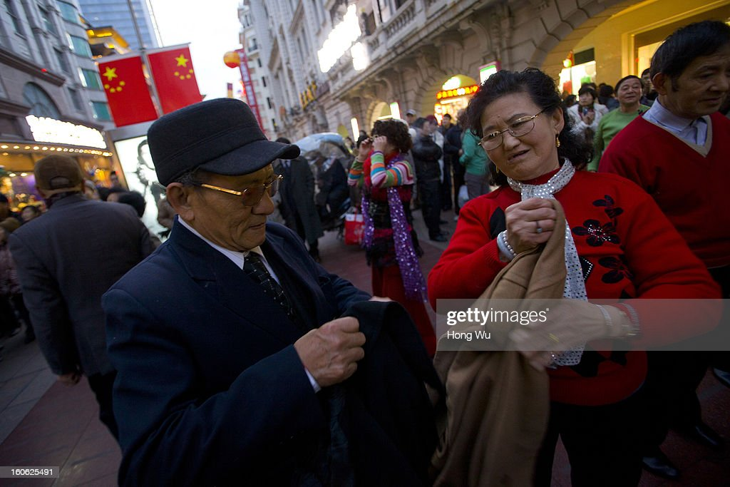 Chinese elder people prepare to dance in Nanjing Road Walking Street on February 3, 2013 in Shanghai, China.