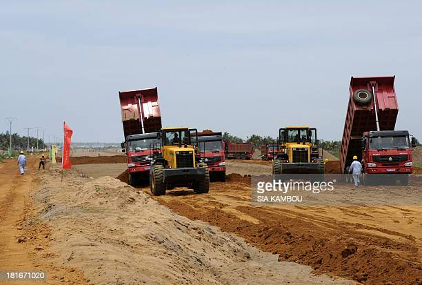 Chinese employees of the Chinese company CEMEC work on September 22 2013 in Bassam on the construction site of a highway between Abidjan and Bassam...